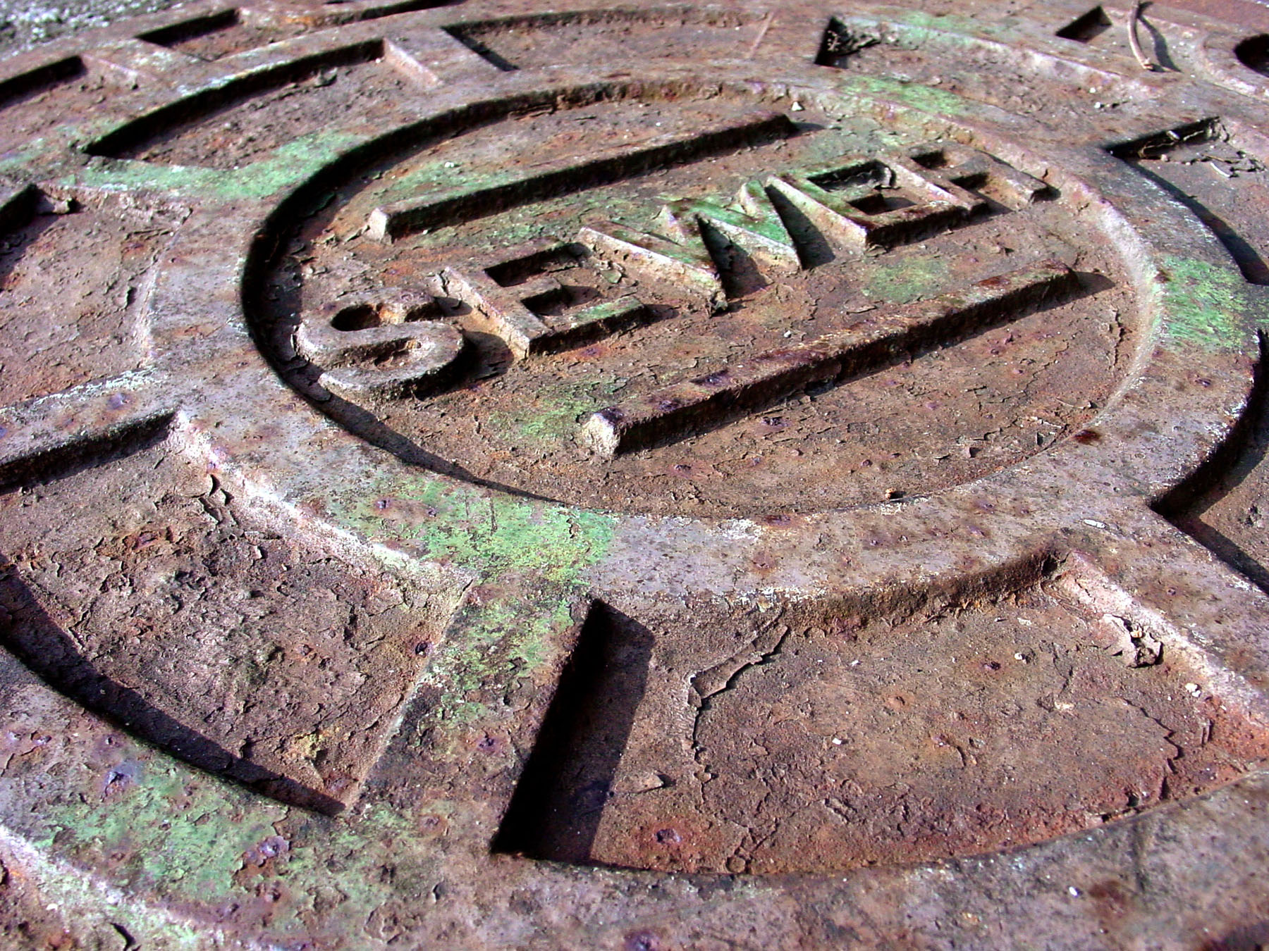 Rusted sewer manhole cover