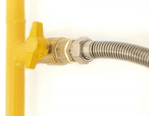 Yellow gas pipe with a valve.