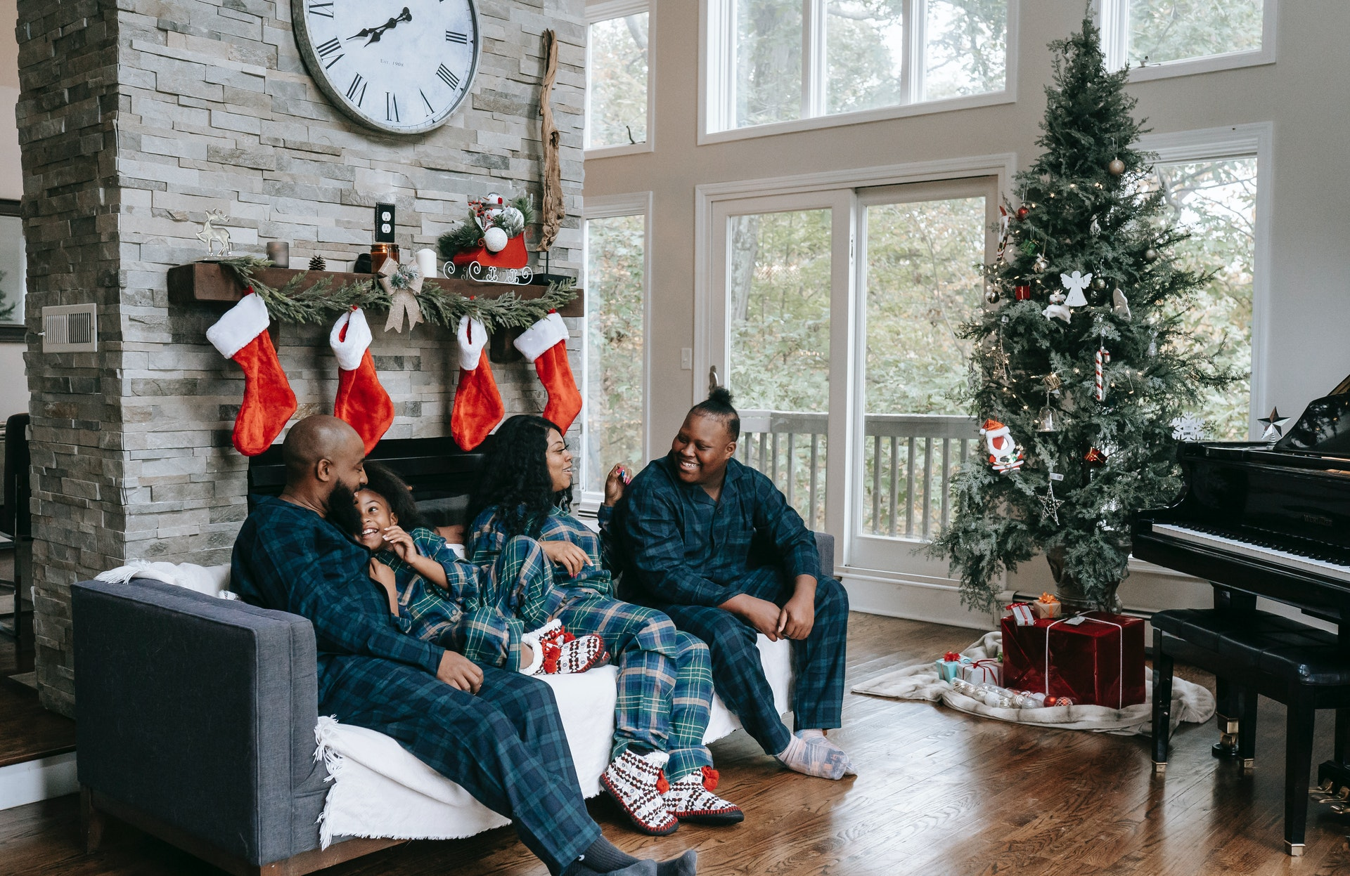 Family sitting in their living room during Christmas