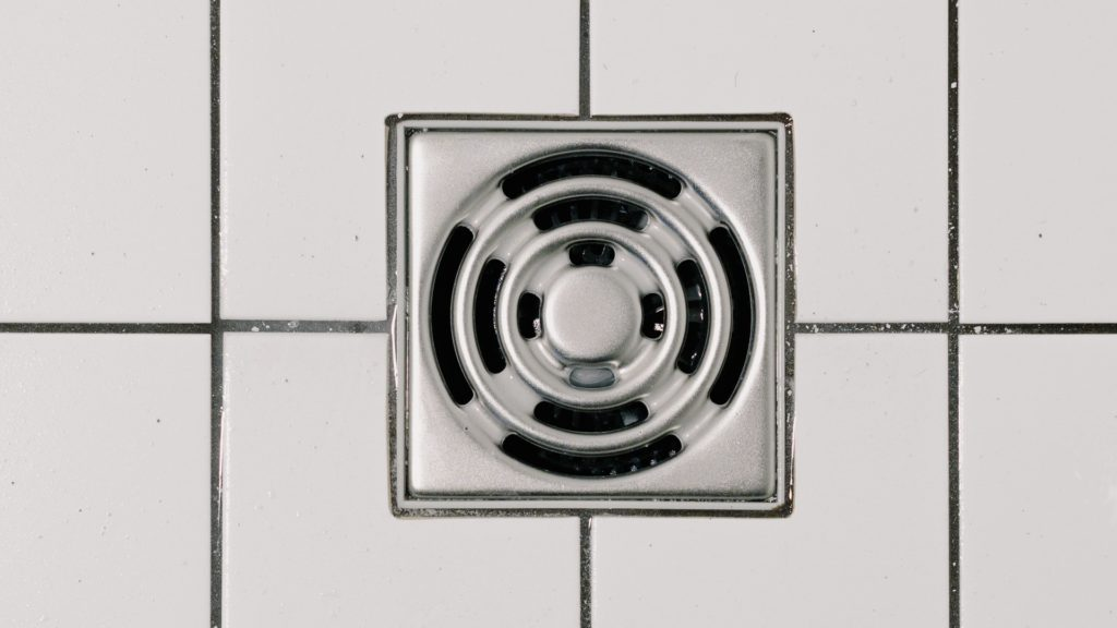 Close up of a shower drain