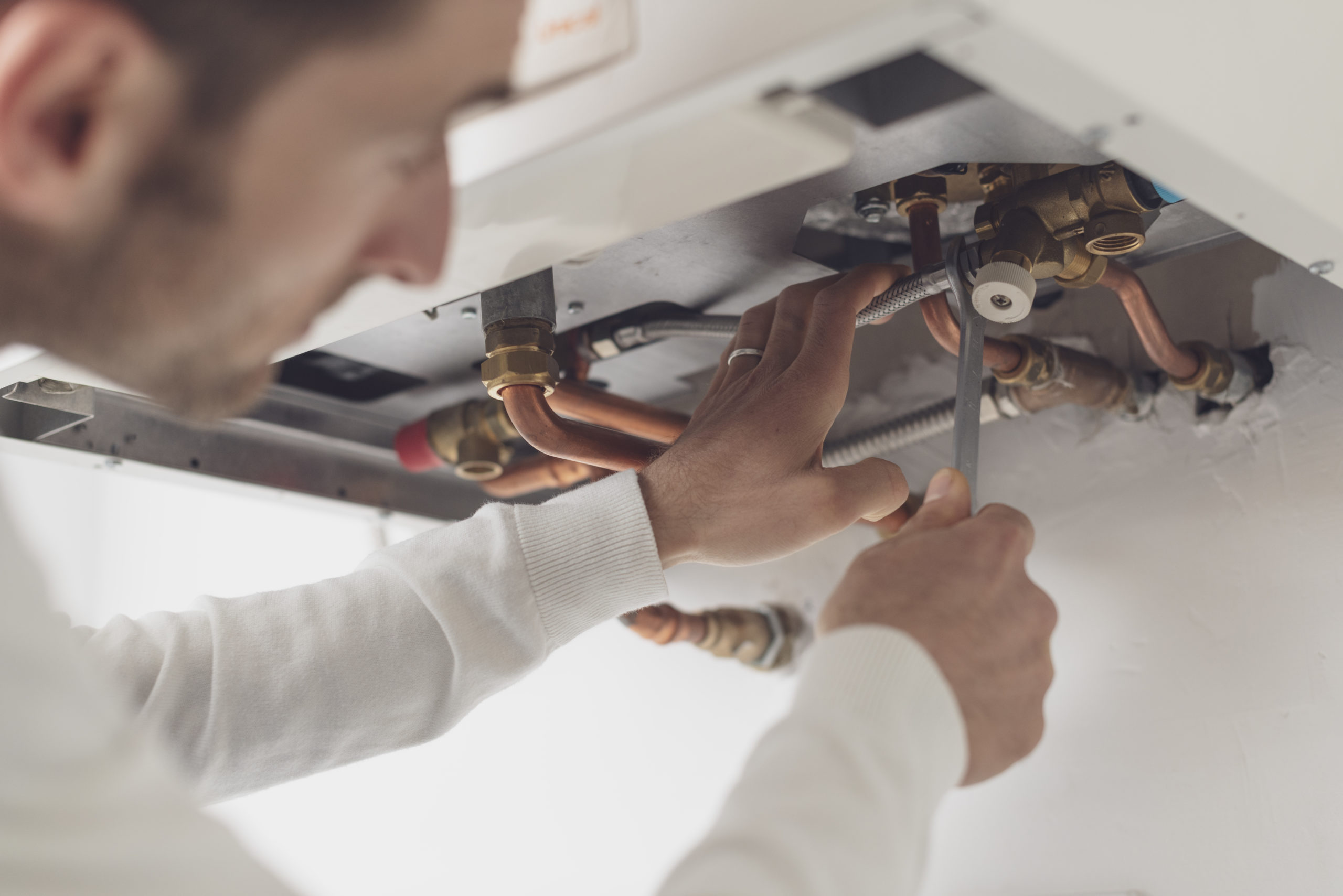 Professional plumber checking a boiler