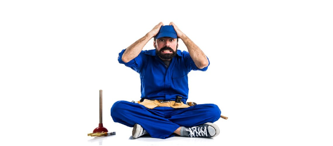 Frustrated plumber beside a plunger
